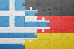 Puzzle with the national flag of greece and germany Stock Photos