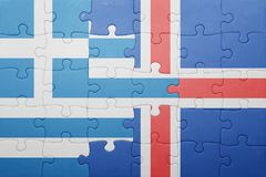 Puzzle with the national flag of greece and iceland. Concept Stock Photos
