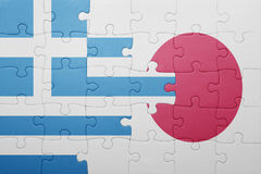 Puzzle with the national flag of greece and japan Stock Photo
