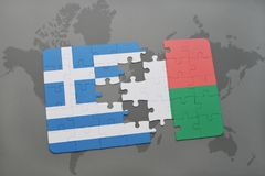 Puzzle with the national flag of greece and madagascar on a world map background. 3D illustration royalty free stock photos