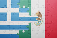 Puzzle with the national flag of greece and mexico Royalty Free Stock Photo