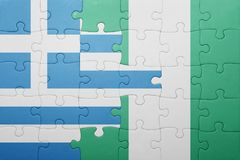Puzzle with the national flag of greece and nigeria. Concept Stock Photography