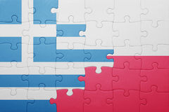 Puzzle with the national flag of greece and poland Royalty Free Stock Photography