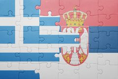 Puzzle with the national flag of greece and serbia . concept Royalty Free Stock Photo