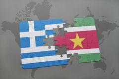 Puzzle with the national flag of greece and suriname on a world map background. 3D illustration Royalty Free Stock Photos