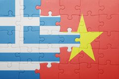 Puzzle with the national flag of greece and vietnam Stock Photos