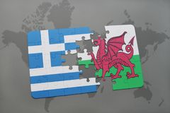 Puzzle with the national flag of greece and wales on a world map background. Stock Photos