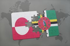 Puzzle with the national flag of greenland and dominica on a world map background. 3D illustration stock images