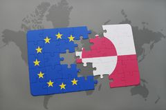 Puzzle with the national flag of greenland and european union on a world map Royalty Free Stock Image