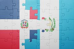 Puzzle with the national flag of guatemala and dominican republic Stock Image