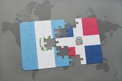 puzzle with the national flag of guatemala and dominican republic on a world map background. Royalty Free Stock Photos