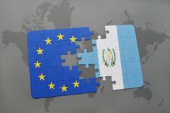 Puzzle with the national flag of guatemala and european union on a world map Royalty Free Stock Photos