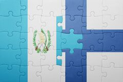 Puzzle with the national flag of guatemala and finland Stock Images