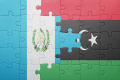 puzzle with the national flag of guatemala and libya Stock Photos