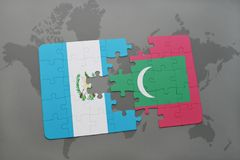 Puzzle with the national flag of guatemala and maldives on a world map Royalty Free Stock Images