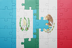 Puzzle with the national flag of guatemala and mexico. Concept stock photos