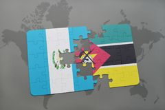 Puzzle with the national flag of guatemala and mozambique on a world map Stock Photography