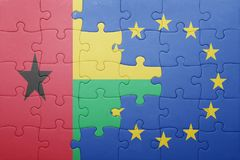 Puzzle with the national flag of guinea bissau and european union Stock Photography