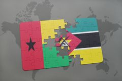 Puzzle with the national flag of guinea bissau and mozambique on a world map Royalty Free Stock Images