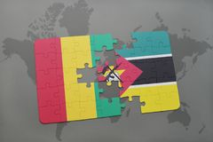 Puzzle with the national flag of guinea and mozambique on a world map Stock Photo