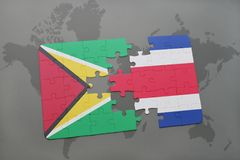 puzzle with the national flag of guyana and costa rica on a world map background. Royalty Free Stock Photography