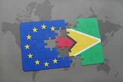 Puzzle with the national flag of guyana and european union on a world map Stock Photo