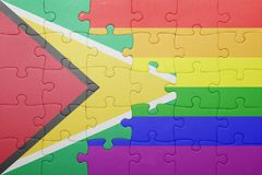 Puzzle with the national flag of guyana and gay flag. Concept Stock Images