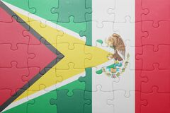 Puzzle with the national flag of guyana and mexico. Concept stock image