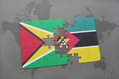 Puzzle with the national flag of guyana and mozambique on a world map. Background. 3D illustration Royalty Free Stock Images