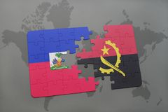 Puzzle with the national flag of haiti and angola on a world map Royalty Free Stock Photo