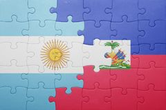 Puzzle with the national flag of haiti and argentina Stock Images