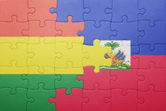 Puzzle with the national flag of haiti and bolivia Stock Photos
