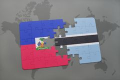 Puzzle with the national flag of haiti and botswana on a world map Stock Image