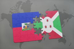 Puzzle with the national flag of haiti and burundi on a world map Stock Image