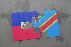 Puzzle with the national flag of haiti and democratic republic of the congo on a world map Stock Photography