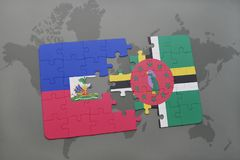 Puzzle with the national flag of haiti and dominica on a world map background. 3D illustration stock photos