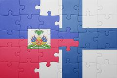 Puzzle with the national flag of haiti and finland Royalty Free Stock Image