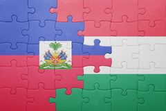 Puzzle with the national flag of haiti and hungary. Concept royalty free stock image