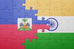 Puzzle with the national flag of haiti and india. Cotncept Stock Photos