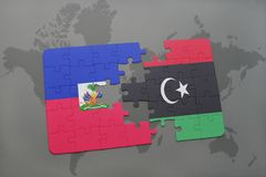 Puzzle with the national flag of haiti and libya on a world map Stock Photo