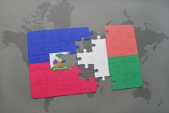 Puzzle with the national flag of haiti and madagascar on a world map Royalty Free Stock Photos