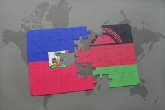 Puzzle with the national flag of haiti and malawi on a world map Royalty Free Stock Image