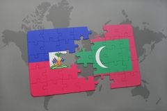 Puzzle with the national flag of haiti and maldives on a world map. Background. 3D illustration Stock Image