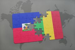 Puzzle with the national flag of haiti and mali on a world map Royalty Free Stock Photo