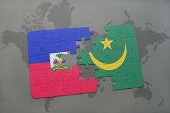 Puzzle with the national flag of haiti and mauritania on a world map Royalty Free Stock Photos
