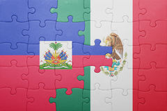 Puzzle with the national flag of haiti and mexico. Concept royalty free stock images