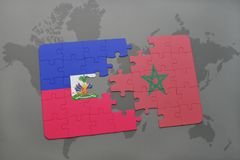 Puzzle with the national flag of haiti and morocco on a world map Stock Photos
