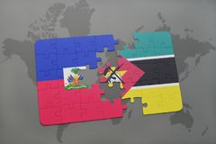 Puzzle with the national flag of haiti and mozambique on a world map Royalty Free Stock Photo