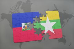 Puzzle with the national flag of haiti and myanmar on a world map Stock Image