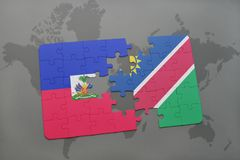 Puzzle with the national flag of haiti and namibia on a world map Royalty Free Stock Photography